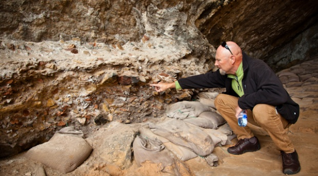 Dr Peter Nilssen indicating Middle Stone Age material in Cave 13B, Pinnacle Point, Mossel Bay, South Africa
